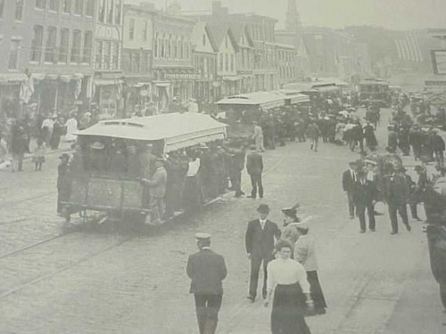 Main Street in downtown Waterville c.1900, electric trolleys in view.
