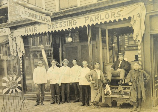 Pomerleau's Hair Dressing Parlors and shoe shine, approx. 1870-1875.