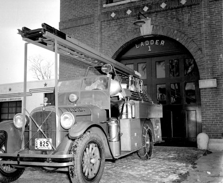 Ladder 1 at Central Fire Station, Texaco station to the left.